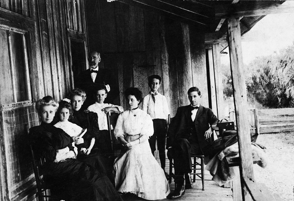 On the porch of the caretaker's house. 1907. Black & white photonegative, 4 x 5 in. State Archives of FL, Florida Memory. L-R: Mary Weedon Hazen, May McNeer, Isabelle Weedon McNeer, Dr. Leslie W. Weedon, Weedon McNeer, Mrs. Carhart, Harry Lee Weedon, Mr. Carhart