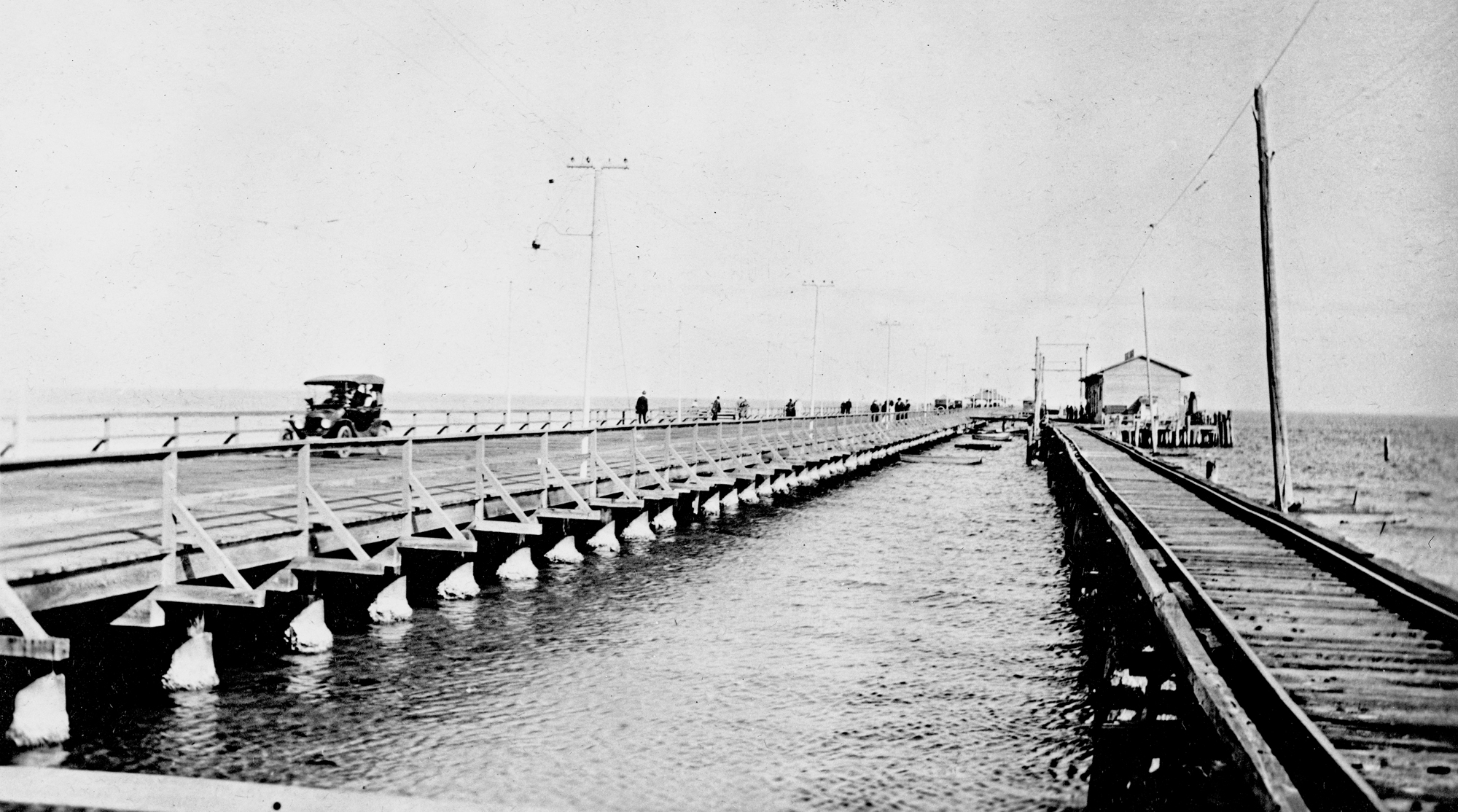 Municipal pier and railroad pier - Saint Petersburg, Florida. 1917 or 1918. Black & white photonegative, 4 x 5 in. State Archives of Florida, Florida Memory.