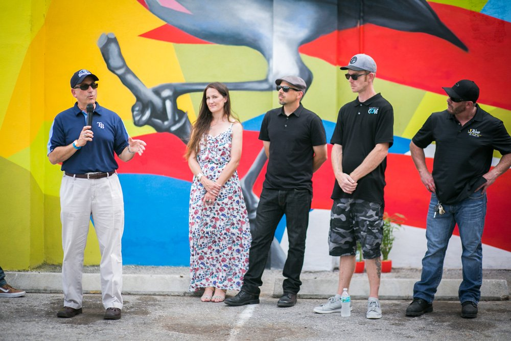 Mayor Rick Kriseman with muralists Cecilia Lueza, Daas and Derek Donnelly Photo by Andrejka Photography