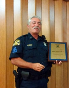 Officer Ray Merritt accepting award presented by the Magnolia Heights Neighborhood Association