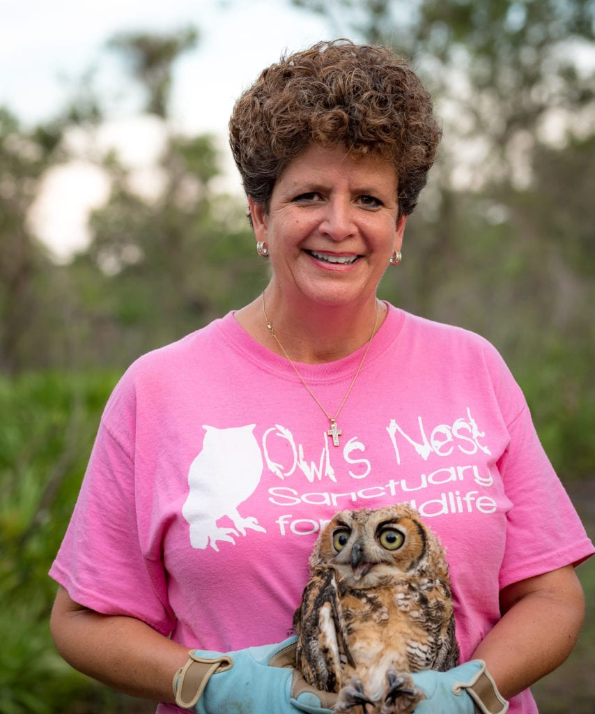 Owl's Nest Sanctuary founder, Kris Porter with a Great Horned Owl fledgling. Photo by Douglas DeFelice/Prime 360 Photography.