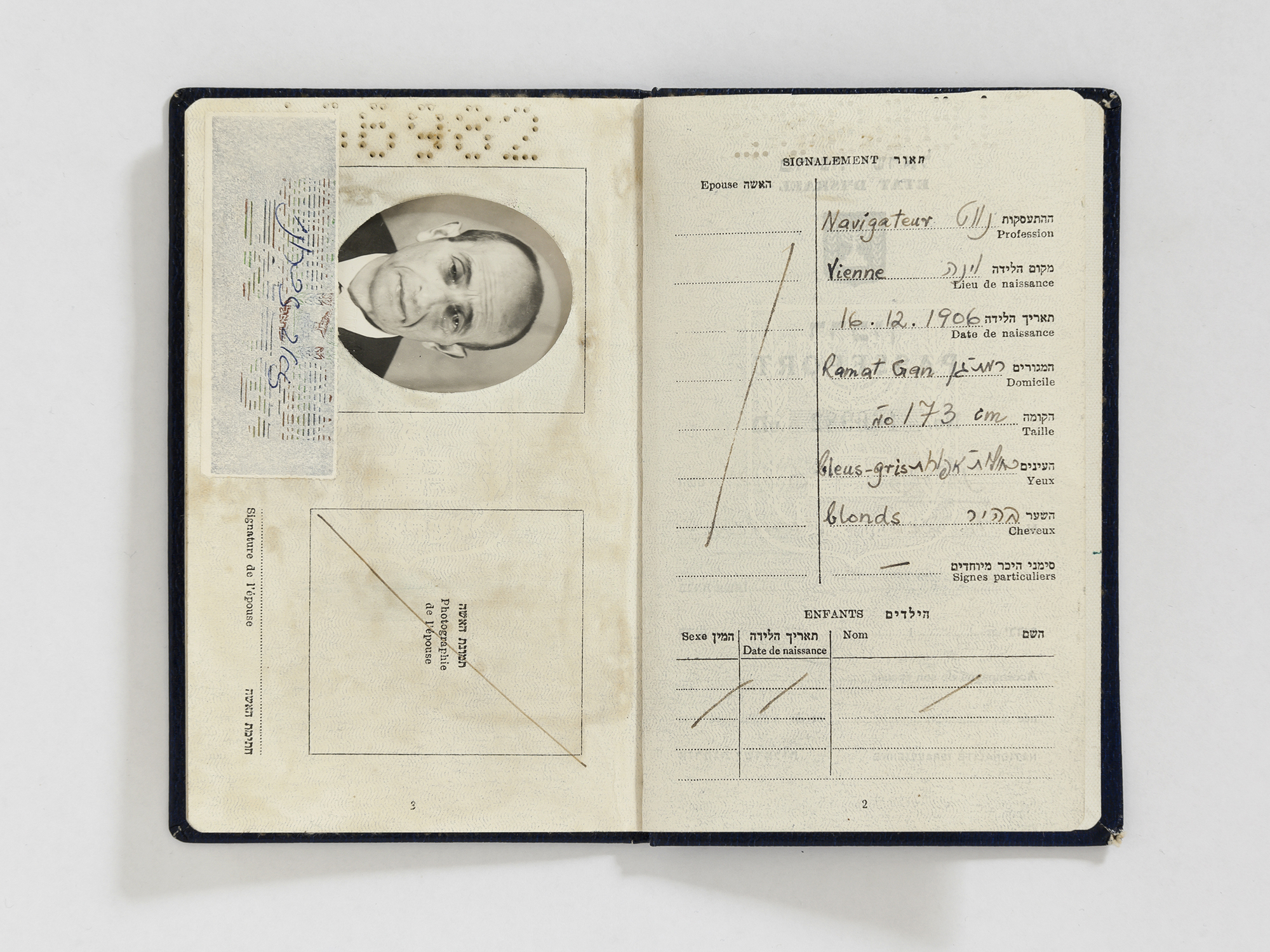 """Falsified Israeli passport prepared for Adolf Eichmann in the name of """"Ze'ev Zichroni,"""" including a photograph that was taken and developed in the safe house, 1960 Photo courtesy of Mossad Archive"""